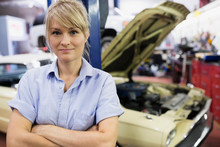 Portrait Confident Female Mechanic In Auto Repairs Hop