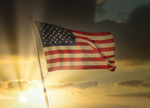 American Flag Flies With Golde...