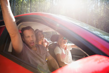 Enthusiastic Friends Singing And Cheering In Car