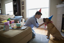 Woman And Dog Celebrating Birthday Face To Face