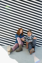 Boy And Girl Texting Black White Striped Wall
