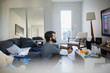 Man playing video game in living room