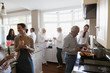Multi-generation family cooking and socializing in kitchen
