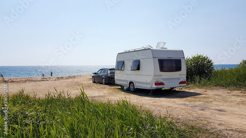 Canvas Print trailer caravan car by the sea, holidays in the nature outdoor by the sea