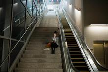 Teenage Girl Using Digital Tablet Stairs Train Station