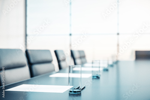 Obraz Close up of conference room with glasses of water on the table with papers, armchairs and a large window. 3D Rendering - fototapety do salonu