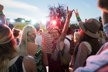 Portrait Enthusiastic Young Man Gesturing In Crowd At Summer Music Festival