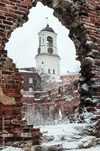 Fototapeta View of the clock tower from the window of the destroyed Church, Vyborg, Russia,