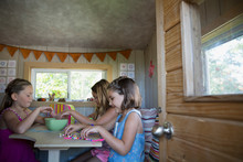 Girls Doing Crafts In Treehouse