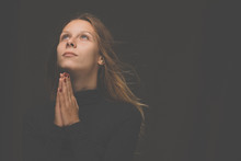 Young Woman Praying  To God. C...