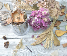 Potpourri In A Glass Jar And Bouquet Of Dry  Flowers