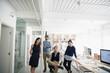 Portrait confident architects in open plan office