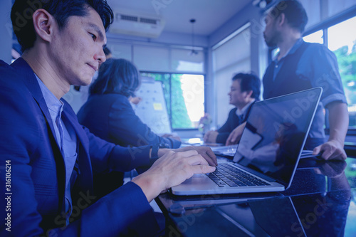Fototapety, obrazy: Businessman using computer laptop while meeting and analyzing data together in teamwork for planning and startup new project.