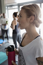 Close Up Serious Woman With Water Bottle After Yoga Class