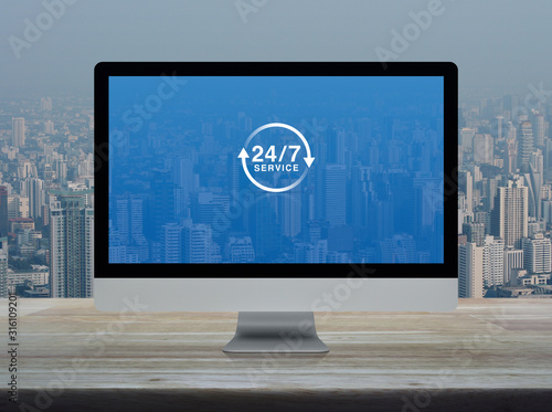 24 hours service flat icon on desktop modern computer monitor screen on wooden t Wallpaper Mural