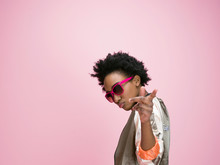 Portrait Cool African American Young Woman Gesturing Against Pink Background
