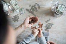 Overhead View Father Teaching Daughter Counting Allowance Money