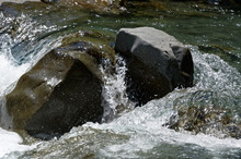 Water Cascades Over A Large Bo...