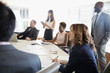 Business people watching presentation in conference room meeting