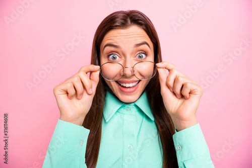 Obraz Closeup photo of charming lady not believe eyes taking off glasses can see perfectly without lens wear specs teal shirt with collar isolated pink color background - fototapety do salonu
