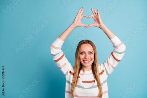 Obraz Photo of cheerful positive pretty nice gorgeous woman showing heart shape sign smile toothy beaming isolated pastel color background - fototapety do salonu