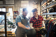Motorcycle Shop Owner Helping ...