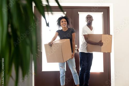 Vászonkép Excited black couple impressed entering new home together