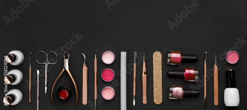 Obraz Above view of manicure and pedicure tools on black background - fototapety do salonu