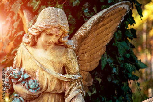 Fotografering Positive, affirming image with an angel figure in sunlight