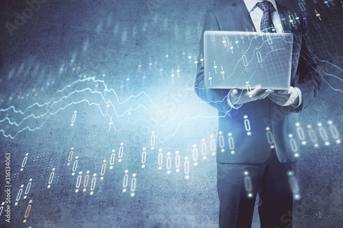Fototapeta  Forex graph with businessman working on laptop on background