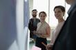 Creative business people with digital tablet brainstorming in office meeting