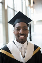 Portrait Smiling, Confident Male College Student In Cap And Gown