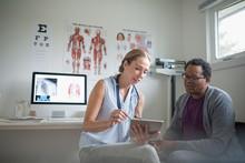 Female Doctor With Digital Tab...