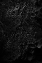 Dark Face Shabby Cliff Face An...