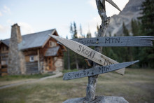 Rustic, Wooden Signpost Outside Log Cabin Lodge