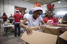 Smiling Girl Volunteer In Sant...