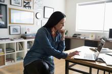 Focused Creative Businesswoman Entrepreneur Working At Laptop In Studio Office
