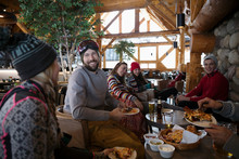 Friends Enjoying Apres-ski Bee...