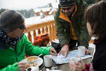 Mature Friend Skiers Enjoying ...