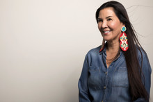 Smiling, Confident Mature Native American Woman With Colorful Earrings