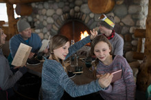 Twin Sister Skiers Taking Selfie At Fireside Ski Resort Lodge Apres-ski