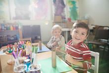 Portrait Smiling Boy Making Ar...