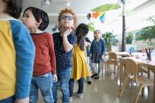 Preschool Students Lining Up In Classroom