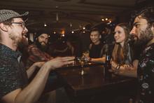 Millennial Friends Drinking An...