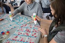 Senior Women Playing Multiple Bingo Cards