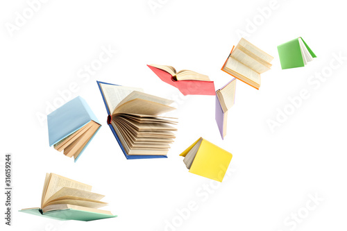 Fototapeta Colorful hardcover books flying on white background