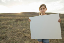 Portrait Of Girl Holding Blank Billboard During Field Trip