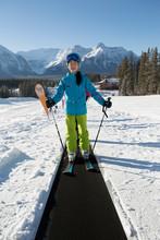 Portrait Confident Girl Skier On Ski Resort Ski Slope