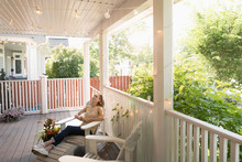 Carefree Woman Relaxing On Summer Porch