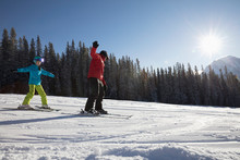 Girl Receiving Ski Lesson From...
